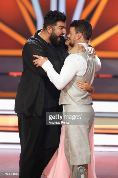 Faisal Kawusi and Heinrich Popow react on stage during the 7th show of the tenth season of the television competition 'Let's Dance' on May 5 2017 in...