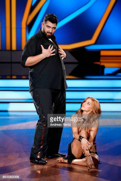 Faisal Kawusi and Oana Nechiti perform on stage during the 1st show of the tenth season of the television competition 'Let's Dance' on March 17 2017...