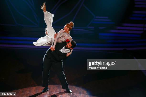 Faisal Kawusi and Oana Nechiti perform on stage during the 2nd show of the tenth season of the television competition 'Let's Dance' on March 24 2017...