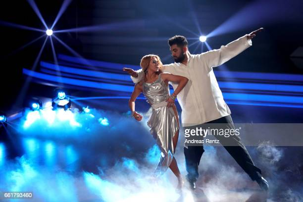 Faisal Kawusi and Oana Nechiti perform on stage during the 3rd show of the tenth season of the television competition 'Let's Dance' on March 31 2017...