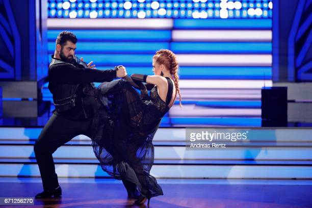 Faisal Kawusi and Oana Nechiti perform on stage during the 5th show of the tenth season of the television competition 'Let's Dance' on April 21 2017...