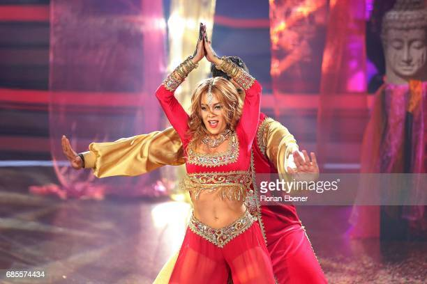 Faisal Kawusi and Oana Nechiti perform on stage during the 9th show of the tenth season of the television competition 'Let's Dance' on May 19 2017 in...