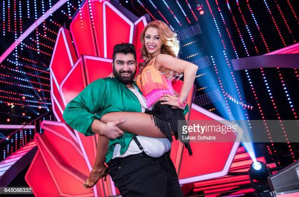 Faisal Kawusi and Oana Nechiti pose on stage after the preshow 'Wer tanzt mit wem Die grosse Kennenlernshow' of the television competition 'Let's...