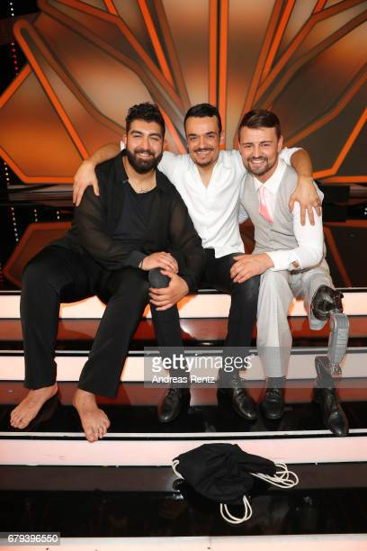 Faisal Kawusi Giovanni Zarrella and Heinrich Popow pose on stage during the 7th show of the tenth season of the television competition 'Let's Dance'...