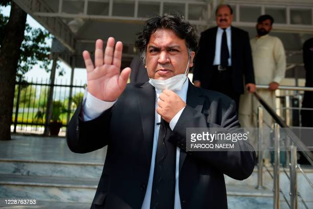 Faisal Siddiqi, lawyer of Daniel Pearl's family, the US journalist who was kidnapped and killed on 2002 in Pakistan, gestures as he leaves the...