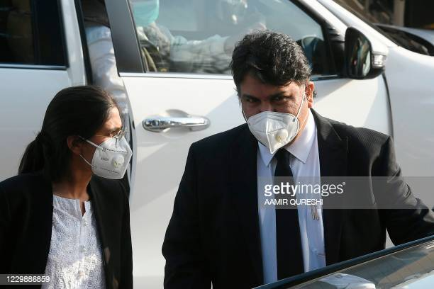 Faisal Siddiqui , a lawyer representing slain US journalist Daniel Pearl's family, leaves the Supreme Court after a hearing in Islamabad on December...