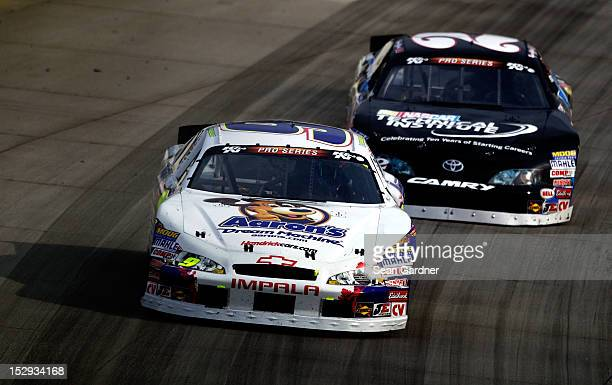 Faison driver of the Aaron's/HendricksCarscom Chevrolet leads Ryan Gifford driver of the NASCAR TechInst10th Anniv/UTI during the NASCAR KN Pro...