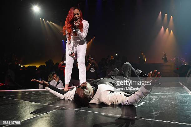 """Faith and Sean """"Diddy"""" Combs aka Puff Daddy perform onstage during the Puff Daddy and The Family Bad Boy Reunion Tour presented by Ciroc Vodka And..."""