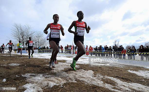 Faith Chepngetich Kipyegon and Agnes Jebet Tirop of Kenya lead the Junior Womens Race during the 40th IAAF World Cross Country Championship 2013 on...