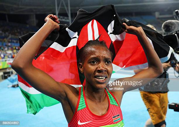 Faith Chepngetich Kipyegon of Kenya celebrates after winning the gold medal in the Women's 1500m Final on Day 11 of the Rio 2016 Olympic Games at the...
