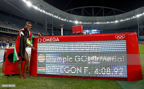 Faith Chepngetich Kipyegon of Kenya poses after winning the gold medal in the Women's 1500m Final on Day 11 of the Rio 2016 Olympic Games at the...