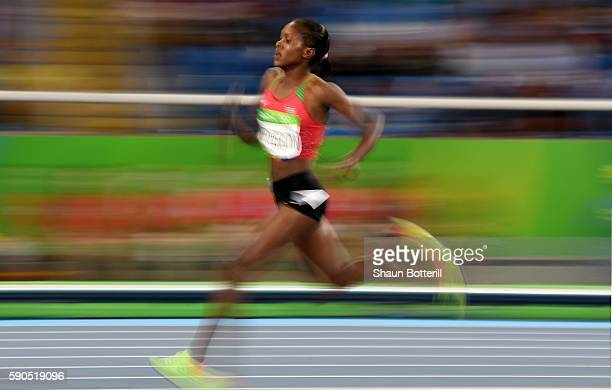 Faith Chepngetich Kipyegon of Kenya runs on her way to winning the gold medal in the Women's 1500m Final on Day 11 of the Rio 2016 Olympic Games at...
