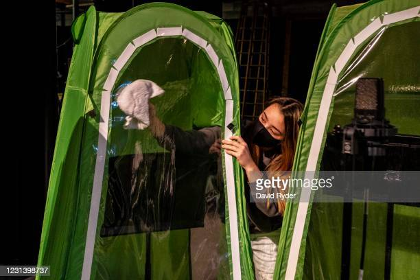 Faith Colman disinfects her pop-up tent at the end of choir class at Wenatchee High School on February 26, 2021 in Wenatchee, Washington. The school...