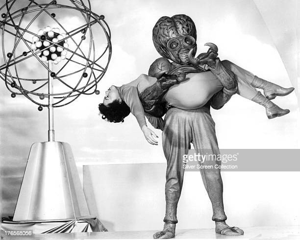 Faith Domergue as Dr Ruth Adams in the clutches of the Mutant in a publicity still for 'This Island Earth' directed by Joseph M Newman 1955 The...