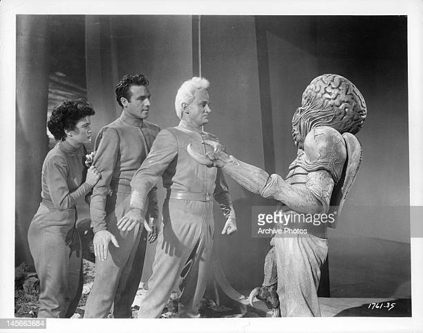 Faith Domergue Rex Reason and Jeff Morrow facing off with alien in a scene from the film 'This Island Earth' 1955