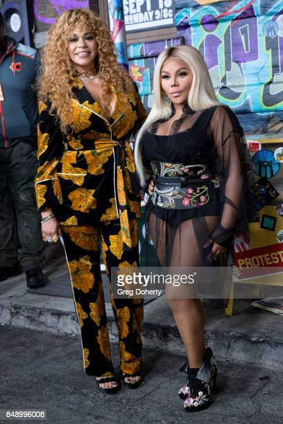 Faith Evans and Lil Kim arrive for VH1's Hip Hop Honors The 90's Game Changers at Paramount Studios on September 17 2017 in Hollywood California