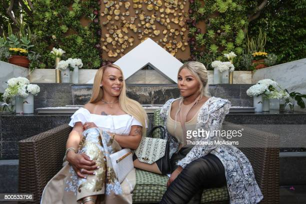 Faith Evans and Lil Kim at Four Seasons Hotel Los Angeles at Beverly Hills on June 23 2017 in Los Angeles California