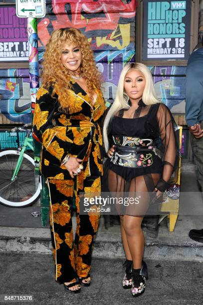 Faith Evans and Lil' Kim attend VH1 Hip Hop Honors The 90s Game Changers at Paramount Studios on September 17 2017 in Los Angeles California