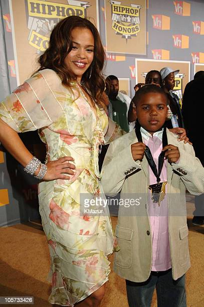 Faith Evans and son Christopher Wallace Jr during 2005 VH1 Hip Hop Honors Gold Carpet at Hammerstein Ballroom in New York City New York United States