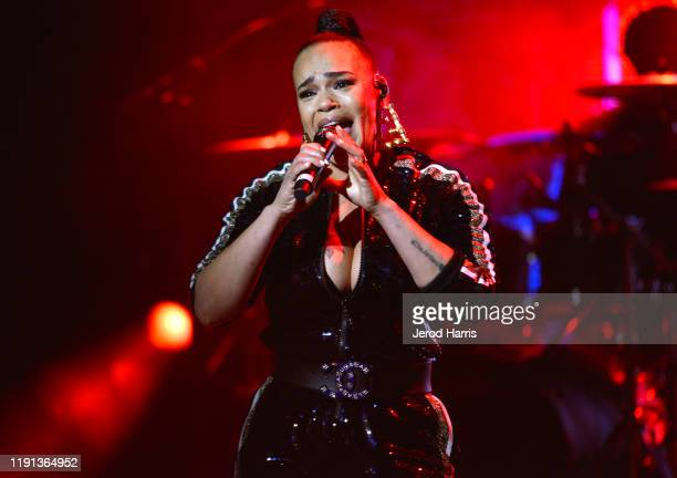 Faith Evans performs at AHF's free World AIDS Day 2019 concert hosted by Primetime Emmy-award winner Billy Porter at the historic Wilshire Ebell...