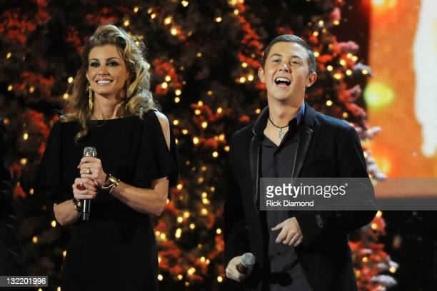 Faith Hill and Scotty McCreery perform at the 2011 Country Christmas at the Bridgestone Arena on November 10 2011 in Nashville Tennessee