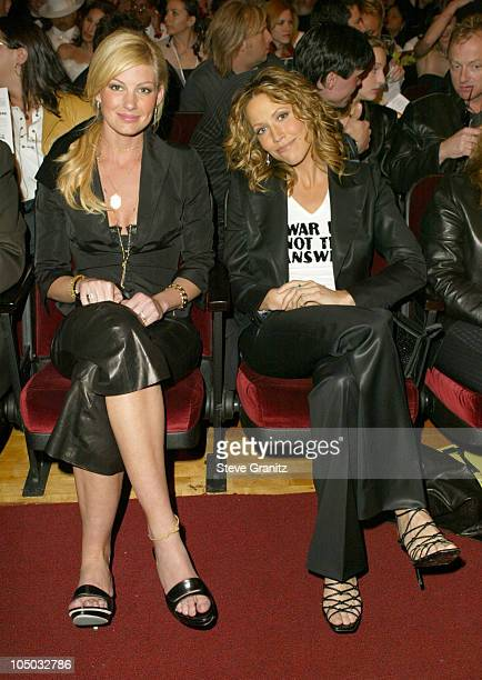 Faith Hill and Sheryl Crow during The 30th Annual American Music Awards Audience and Backstage at Shrine Auditorium in Los Angeles California United...