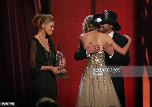 Faith Hill and Tim McGraw onstage with Taylor Swift at the 43rd Annual CMA Awards at the Sommet Center on November 11 2009 in Nashville Tennessee