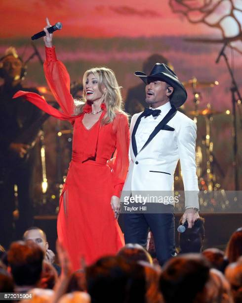 Faith Hill and Tim McGraw perform during the 51st annual CMA Awards at the Bridgestone Arena on November 8 2017 in Nashville Tennessee