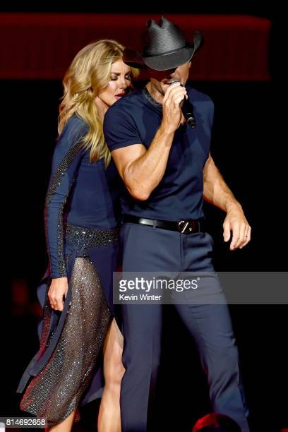 Faith Hill and Tim McGraw perform onstage during the 'Soul2Soul' World Tour at Staples Center on July 14 2017 in Los Angeles California