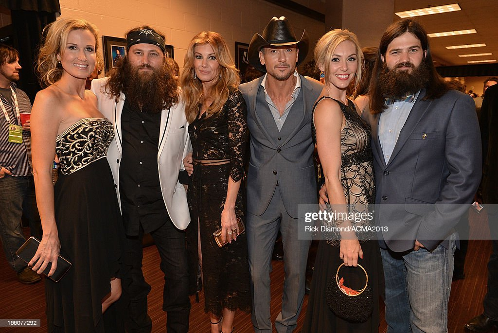 Faith Hill and Tim McGraw (center) with Duck Dynasty's Korie Robertson, Willie Robertson (left) Jessica Robertson and Jep Robertson (right) backstage at the MGM Grand Garden Arena on April 7, 2013 in Las Vegas, Nevada.