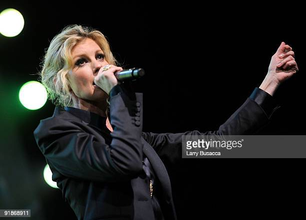 Faith Hill performs onstage at the 'We're All For The Hall' benefit concert for the Country Music Hall of Fame at the Sommet Center on October 13...