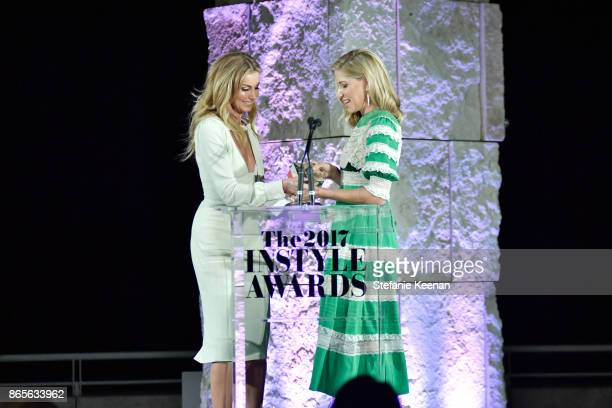 Faith Hill presents Stylist of the Year award to Petra Flannery onstage at the Third Annual InStyle Awards presented by InStyle at The Getty Center...