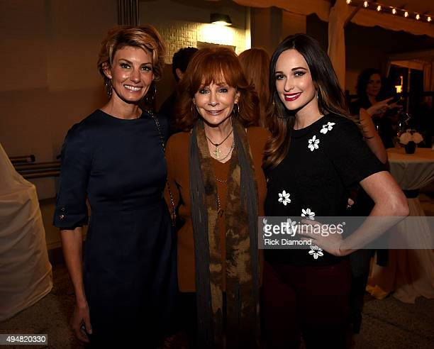Faith Hill Reba McEntire and Kacey Musgraves attend the Draper James Nashville store opening on October 28 2015 in Nashville Tennessee