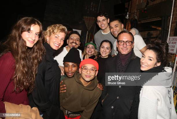 """Faith Hill, Tim McGraw and daughter Audrey Caroline McGraw pose with the cast backstage at the hit musical based on the Baz Luhrmann film """"Moulin..."""