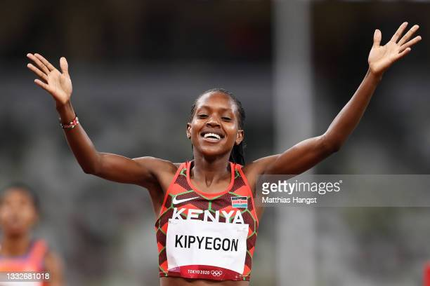 Faith Kipyegon of Team Kenya wins the gold medal during the Women's 1500 metres final on day fourteen of the Tokyo 2020 Olympic Games at Olympic...