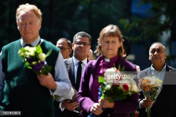 Faith leaders and dignitaries including Britain's Business Secretary Alok Sharma gather to lay flowers at an entrance of Forbury Gardens park in...