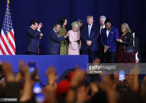 Faith leaders pray over President Donald Trump during a 'Evangelicals for Trump' campaign event held at the King Jesus International Ministry on...