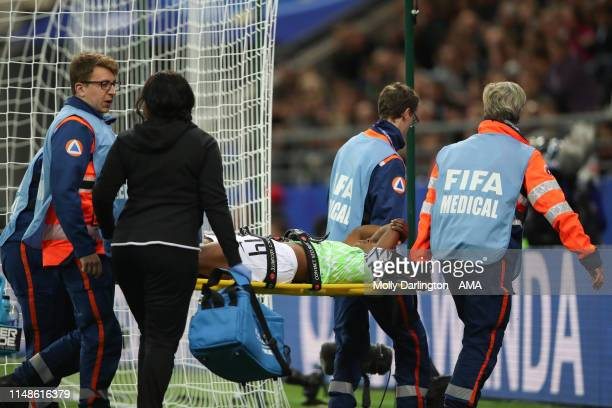 Faith Michael of Nigeria is stretchered off the pitch during the 2019 FIFA Women's World Cup France group A match between Norway and Nigeria at Stade...