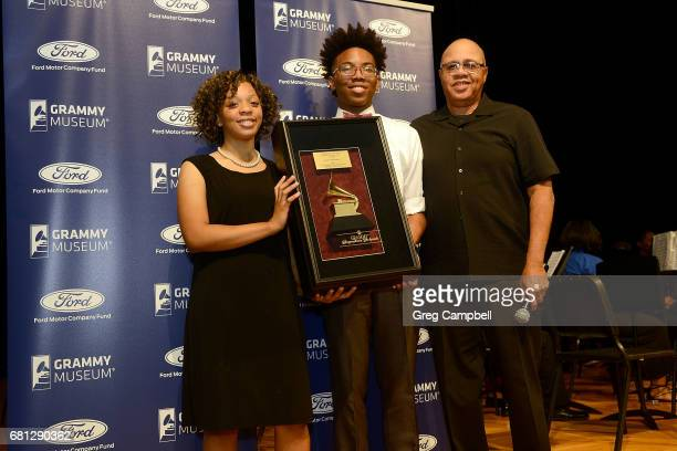 Faith Miller and Cameron Gary students at Overton High School are presented the GRAMMY Signature Schools Enterprise Award by David Sears at Colonial...