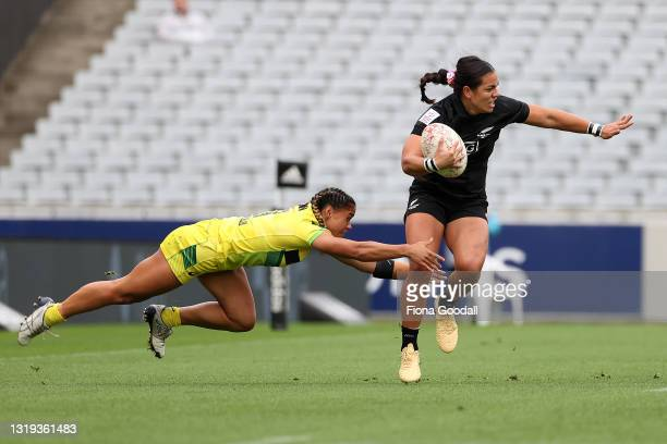 Faith Nathan of the Australian Wallaroos Sevens tackles Stacey Fluhler of the Black Ferns Sevens at Eden Park on May 22, 2021 in Auckland, New...