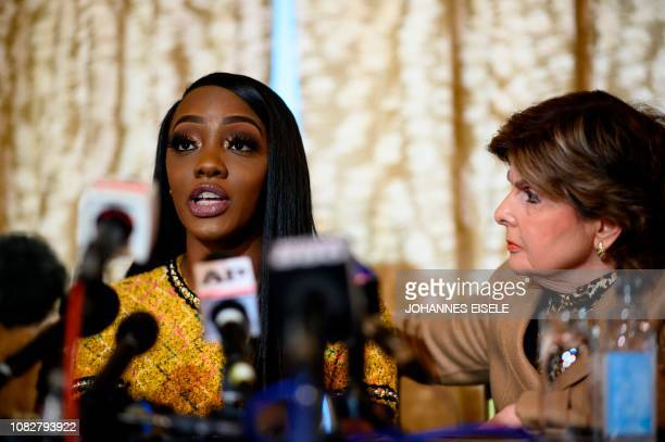 Faith Rodgers and attorney Gloria Allred attend a press conference on January 14 2019 in New York City to respond to the threats and retaliations by...