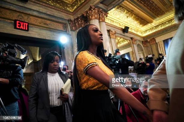 Faith Rodgers arrives for a press conference in Midtown Manhattan to discuss her allegations of sexual physical and mental abuse against singer R...