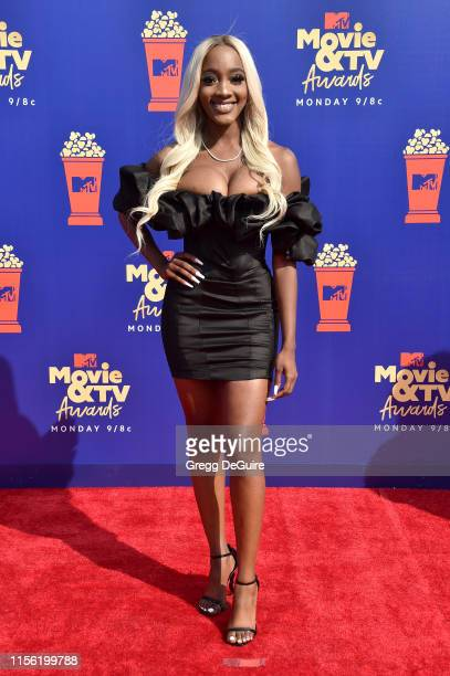 Faith Rodgers attends the 2019 MTV Movie and TV Awards at Barker Hangar on June 15 2019 in Santa Monica California