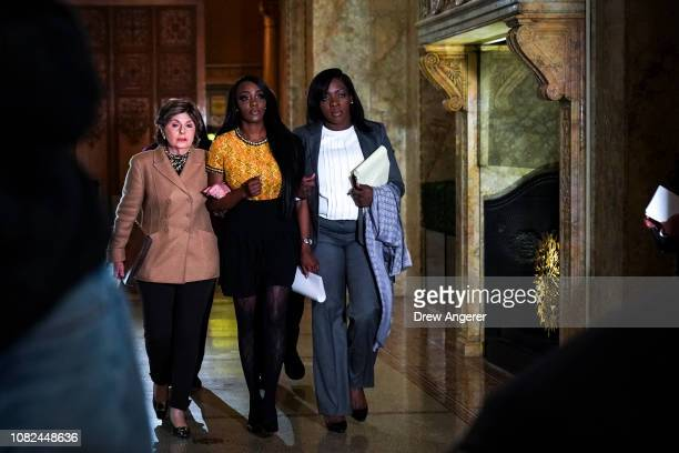 Faith Rodgers flanked by attorneys Gloria Allred and Lydia Hill arrive for a press conference in Midtown Manhattan to discuss Rodgers' allegations of...