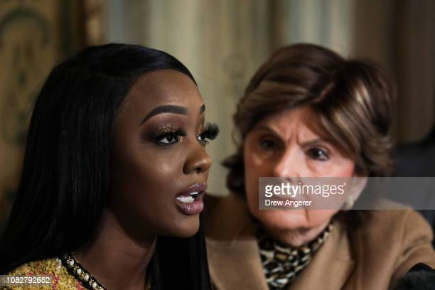 Faith Rodgers speaks as attorney Gloria Allred looks on during a press conference in Midtown Manhattan to discuss Rodgers' allegations of sexual...