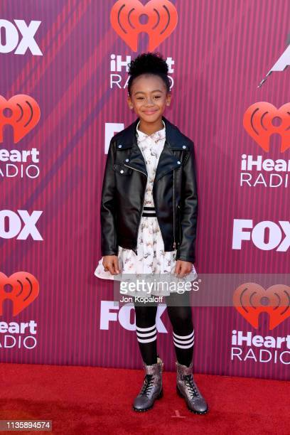 Faithe C Herman attends the 2019 iHeartRadio Music Awards which broadcasted live on FOX at Microsoft Theater on March 14 2019 in Los Angeles...