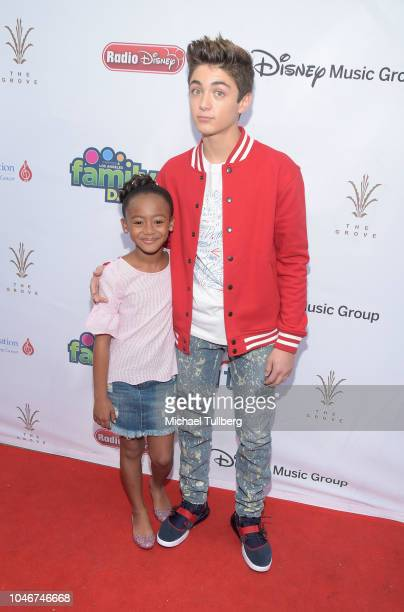 Faithe Herman and Asher Angel attend the 9th annual LA Family Day hosted by the TJ Martell Foundation at The Grove on October 6 2018 in Los Angeles...