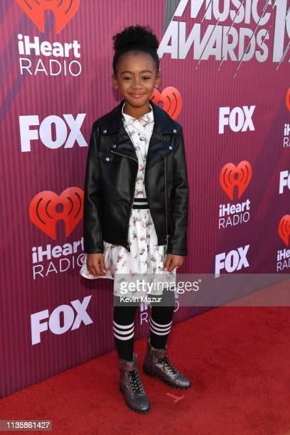 Faithe Herman attends the 2019 iHeartRadio Music Awards which broadcasted live on FOX at Microsoft Theater on March 14 2019 in Los Angeles California
