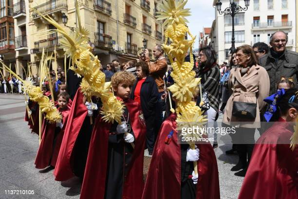 Faithful are seen holding palms during the procession of 'Domingo de Ramos' in Soria, north of Spain. Palm Sunday commemorates the triumphant entry...