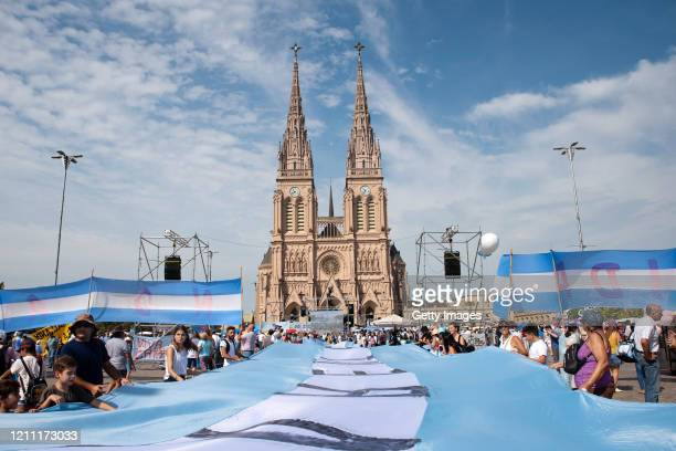 Faithful attend a mass called by the Argentine Catholic Church to in rejection of a bill proposed by President Alberto Fernandez to decriminalize...